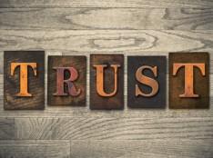 """The word """"TRUST"""" written in vintage wooden letterpress type"""